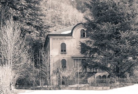 horror: isolated house in the woods seems abandoned, like in a horror movie