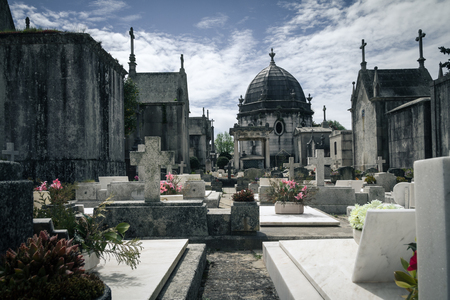 tombstones: Old cemetery with statues and marble tombstones for the graves