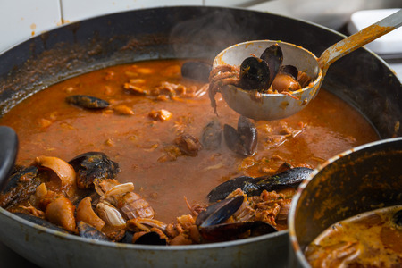 The fish soup is a fish soup made from shellfish, it is a typical dish of Tuscan cuisine. Stock Photo