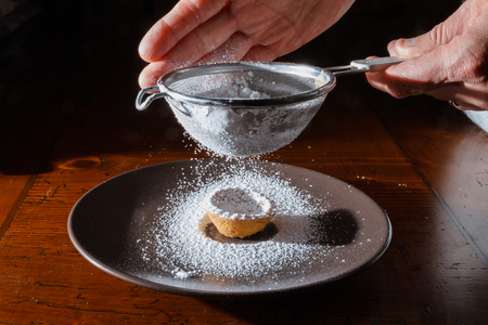 sprinkle with powdered sugar freshly baked cookies