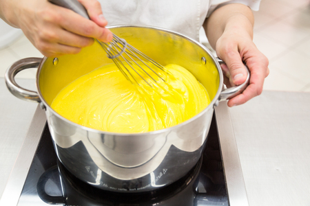 the preparation of the custard used for desserts Reklamní fotografie