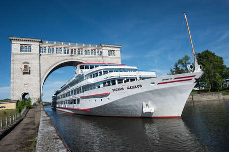uglich russia: Uglich of Yaroslavl region, Russia - June 1, 2015: Passenger ship Zosima Shashkoff is passing through the gateway Uglich hydroelectric power station on the channel of the river Volga.