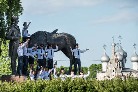 konstantin: Vologda, Russia - May 25, 2015: Kremlins Cathedral Square, Police Academy Graduates photographed against the backdrop of the monument to the Russian poet Konstantin Batyushkov
