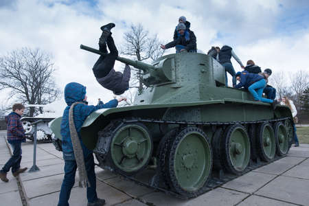 armaments: Leningrad Region, Russia - April 21, 2015: Light Soviet Russian T-26 tank on the square in front of the defense of Leningrad Museum Editorial