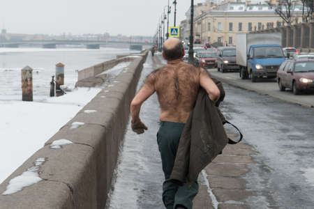 St. Petersburg, Russia - February 15, 2013: a man with a bare-chested in the winter makes the sport jogging along the embankment of the river Neva. Editorial