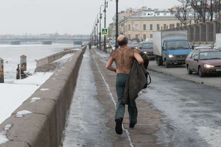 hairy back: St. Petersburg, Russia - February 15, 2013: a man with a bare-chested in the winter makes the sport jogging along the embankment of the river Neva. Editorial