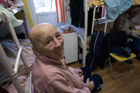 St. Petersburg, Russia - December 24, 2014: homeless shelters, a portrait of a homeless man Editorial