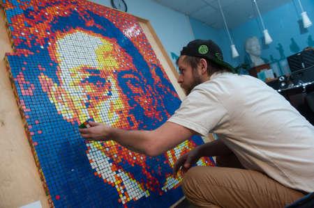 showman: St. Petersburg, Russia - November 28, 2015: Showman Sergei Shmykov held a six-hour public performance - has created portrait writer Anton Chekhov with 2000 Rubiks Cube