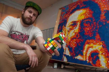 anton: St. Petersburg, Russia - November 28, 2015: Showman Sergei Shmykov held a six-hour public performance - has created portrait writer Anton Chekhov with 2000 Rubiks Cube