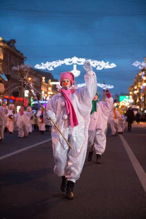 clauses: St. Petersburg, Russia - December 22, 2014: Santa Clauses march along Nevsky Prospekt, Children dressed as snowmen