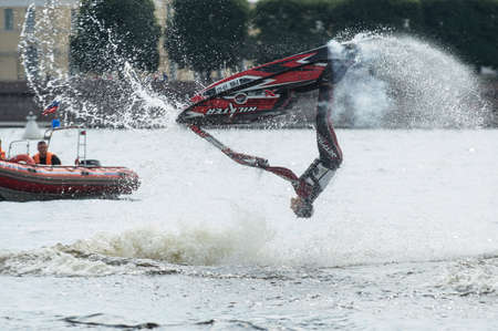 acts: St. Petersburg, Russia - June 7, 2013: Shaw sportsmen racers aquabikes on the Neva River - flips, tricks, Death Defying Acts.