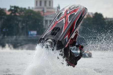 extravagance: St. Petersburg, Russia - June 7, 2013: Shaw sportsmen racers aquabikes on the Neva River - flips, tricks, Death Defying Acts.