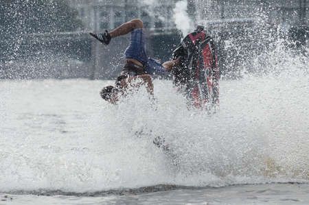 extremity: St. Petersburg, Russia - June 7, 2013: Shaw sportsmen racers aquabikes on the Neva River - flips, tricks, Death Defying Acts.