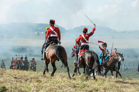 cavalry: St. Petersburg, Russia - August 26: Military historical reconstruction of the War of 1812. Battle Russian and French armies at Borodino, the Battle of Moscow river.