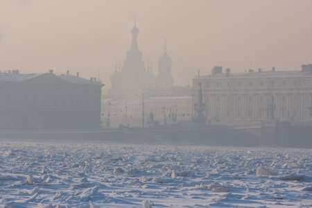 very cold: St. Petersburg, Russia - February 7, 2012: The frozen Neva on a very cold day with a view of the Cathedral of the Saviour on Spilled Blood in the foggy haze frosty