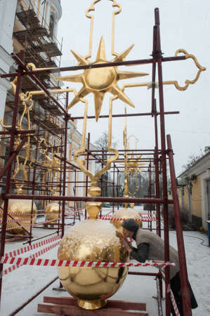 St. Petersburg, Russia - December 16, 2015: Completion of the restoration of gilded crosses Prince Vladimir Cathedral in the courtyard.
