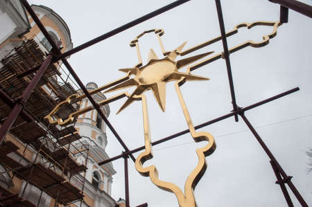 sainthood: St. Petersburg, Russia - December 16, 2015: Completion of the restoration of gilded crosses Prince Vladimir Cathedral in the courtyard.