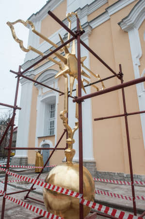 sanctification: St. Petersburg, Russia - December 16, 2015: Completion of the restoration of gilded crosses Prince Vladimir Cathedral in the courtyard.