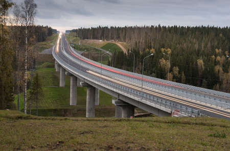 Highway. Bridge on the River with moving cars on it.