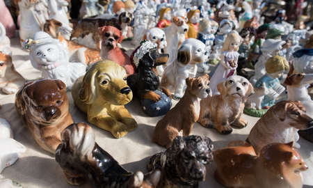 shop for animals: St. Petersburg, Russia - April 11, 2015: Flea market, A large number of statues of dogs of different breeds at the counter