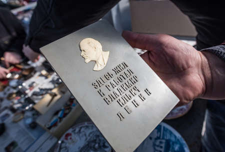plaque: St. Petersburg, Russia - April 11, 2015: Flea market, The memorial plaque with a bust of Lenin in his hand dealer Editorial