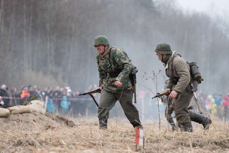 st german: St. Petersburg, Russia - April 26, 2015: Members of the military-patriotic club during the historical reconstruction of World War II battle for the Seelow Heights, German soldiers