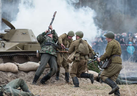 historic world event: St. Petersburg, Russia - April 26, 2015: Members of the military-patriotic club during the historical reconstruction of World War II battle for the Seelow Heights, Dogfight Russian and German soldiers