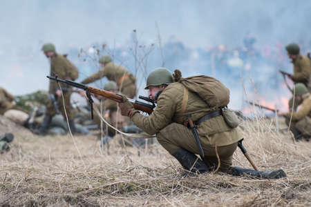 historic world event: St. Petersburg, Russia - April 26, 2015: Members of the military-patriotic club during the historical reconstruction of World War II battle for the Seelow Heights, Soviet Russian troops in the offensive on the battlefield