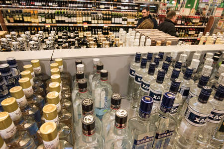 bebidas alcohÓlicas: St. Petersburg, Russia - 6 March 2015: Shelves of wine vodka and spirits alcoholic beverages in hypermarket