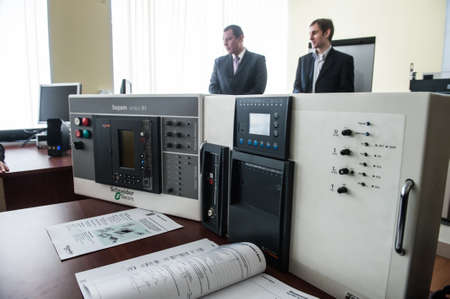 electrical equipment: St. Petersburg, Russia - February 15, 2012: International Scientific and Educational Center of Schneider electric. Students learn in a classroom electrical equipment. Editorial