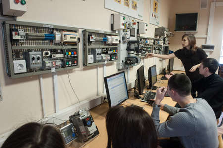 St. Petersburg, Russia - February 15, 2012: International Scientific and Educational Center of Schneider electric. Students learn in a classroom electrical equipment. Redactioneel