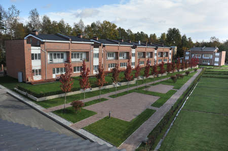 low income housing: St. Petersburg, Russia - September 29, 2015: Country-storey residential block  brick houses an average price category. Editorial