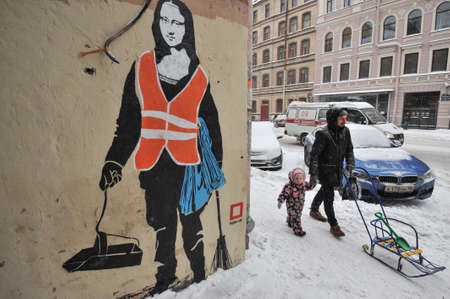 vinci: St.Petersburg, Russia - January 13, 2016: Graffiti on the wall of a residential building in the city center. Woman in uniform of janitor with a broom and a dustpan with a face of the Mona Lisa by Leonardo Da Vinci