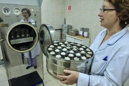 food testing: St. Petersburg, Russia - November 13 2015: biochemical laboratory testing of food products manufactured in large enterprises of the city. Specialists are conducting chemical tests of conformity