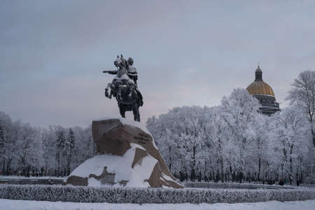 tourist site: St.Petersburg, Russia - January 17, 2016: The Bronze Horseman by Peter the Great - the main attraction of the city,  frosty winter day. The  tourist site