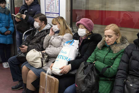 swine flu: St.Petersburg, Russia - January 29, 2016: People are protected against swine flu by a gauze mask  when moving around the city by public transport and the metro. Flu epidemic.