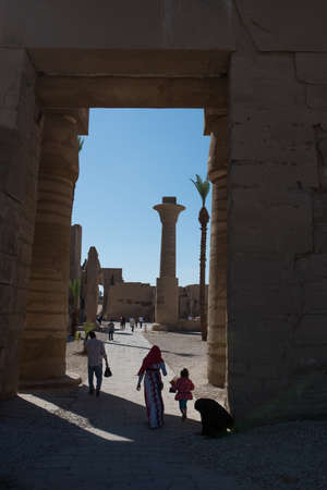 thebes: Luxor, Egypt - November 27, 2014: Karnak Temple complex, open-air museum is visited by numerous tourists from all over the world.