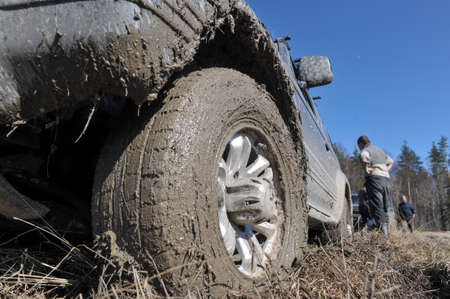 stuck up: Karelia, Russia - April 30, 2015: Riding off-road during the spring thaw, drivers overcome natural obstacles and compete with each other in the driving skills Editorial