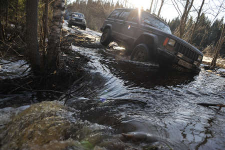 4wd: Karelia, Russia - April 30, 2015: Riding off-road during the spring thaw, drivers overcome natural obstacles and compete with each other in the driving skills Editorial