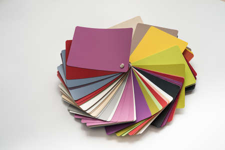 color fan: Glossy PVC plastic cards to select the color of furniture lined fan close-up on a white background