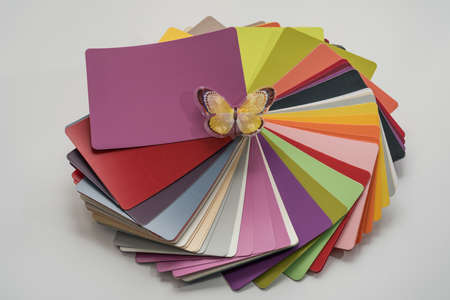 select: Glossy PVC plastic cards to select the color of furniture lined fan close-up on a white background