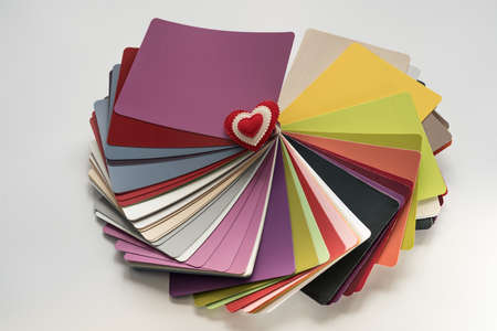 heart tone: Glossy PVC plastic cards to select the color of furniture lined fan close-up on a white background