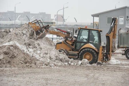 mud and snow: Saint-Petersburg, Russia - January 20, 2016: Factory for processing  of snow by melting and processing of produced water treatment and discharge it into the municipal sewage system.