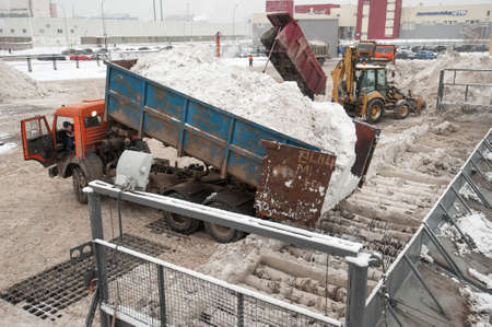 mud snow: Saint-Petersburg, Russia - January 20, 2016: Factory for processing  of snow by melting and processing of produced water treatment and discharge it into the municipal sewage system.