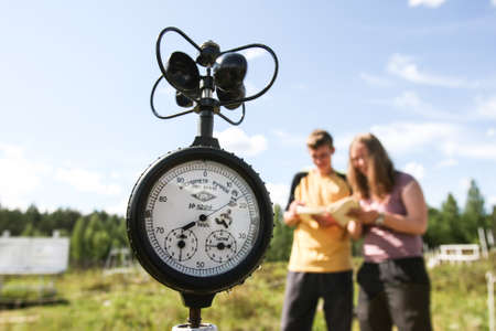 Saint-Petersburg, Russia - July 11, 2015: Meteorological Institute students on practical training in the field of study parameters measuring instruments weather changes, anemometer