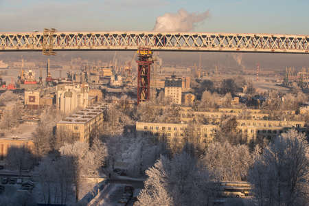 two level house: Saint-Petersburg, Russia - January 23, 2016: Construction of a bridge over the residential area of the city. Winter bright sunny day.