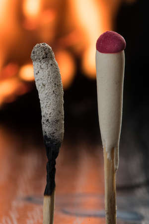 varying: Two special tourist matches for use in difficult weather conditions during rain, wet snow, strong winds. One match - burned, the other - new. Pair of items of varying condition. Contrast.