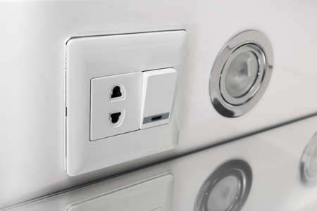 halogen lighting: White halogen lighting switch in the closet in the bathroom. Halogen Lamp