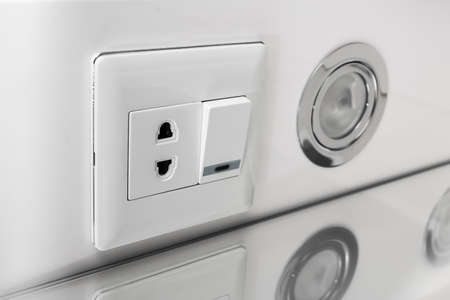 halogen: White halogen lighting switch in the closet in the bathroom. Halogen Lamp