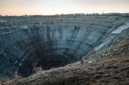 """Kimberlite pipe """"Mir"""" - indigenous diamond deposits. On the way to the bottom of the spiral 8 kilometers. Diameter 1200 meters depth of 525 meters. Yakutia, northern Russia."""
